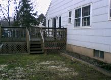 This is the back of the house where the addition is going...after the tree stump is pulled out.