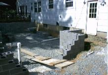 We formed the footings, poured the concrete, and now the block is started for the foundation.