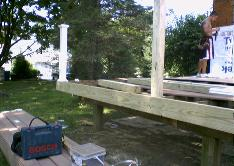 The existing deck was rebuilt, and extended into the new addition.