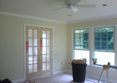 The wood French doors were installed, which really adds a nice feeling to the room.