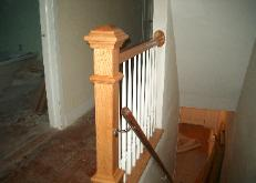 There used to be a wall here, but we knocked most of it down, and put a newel post, and railings.