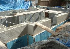 We filled the walls solid with concrete. That doorway at the rear is for the bilko door.