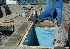The foundation was wrapped with a two inch solid insulation.